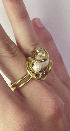 2013-07 Ring Angelic Gold 2 (on hand side).jpg