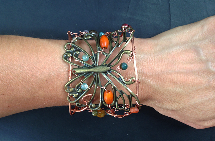 2014 Copper cuff with brass butterfly on hand.jpg