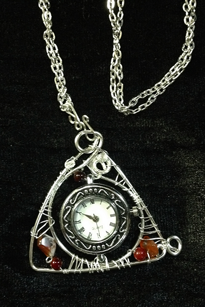 2014 Triangle watch with silverplated chain