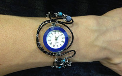 2014 Black coated copper watch with blue face on hand