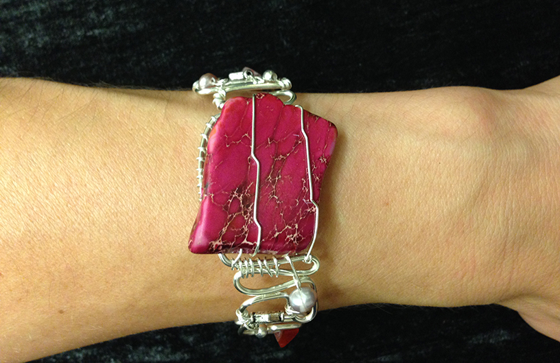 2014 Silver plated copper cuff with pink stone on hand