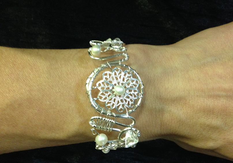 2014 Silver plated copper cuff with river pearls on hand