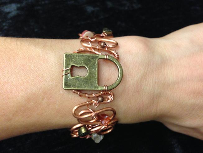 2014 copper cuff with lock on hand