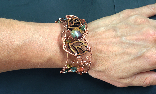 2014 Copper Cuff with wood leafs on hand