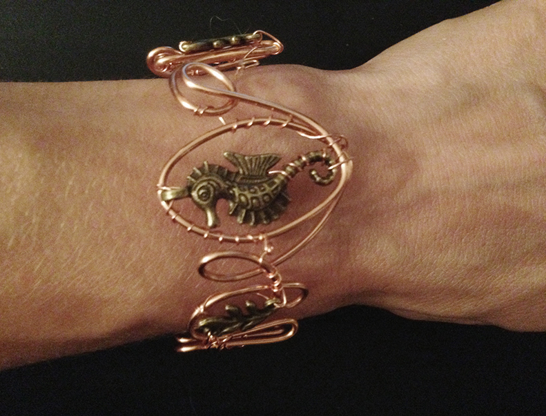 2014 copper cuff seahorse on hand.jpg