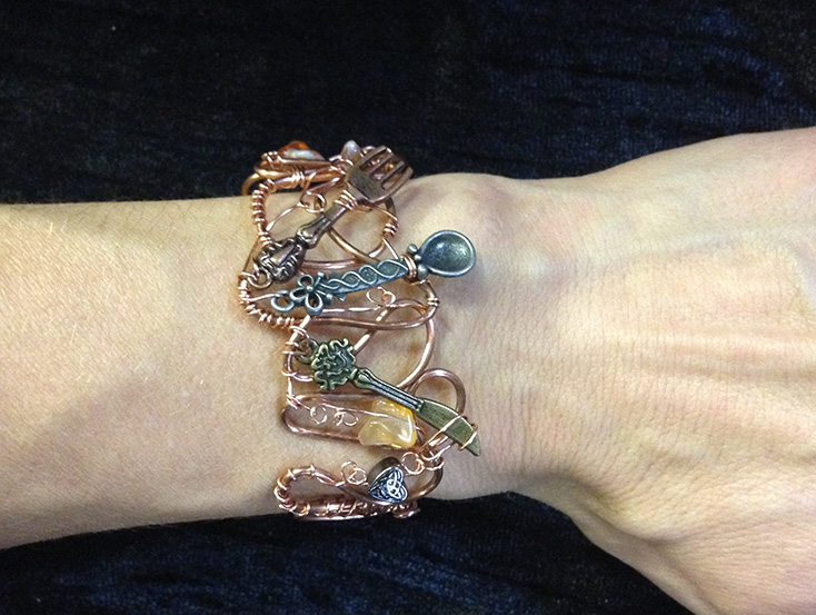 2014 Copper Cuff with tiny silverwear on hand