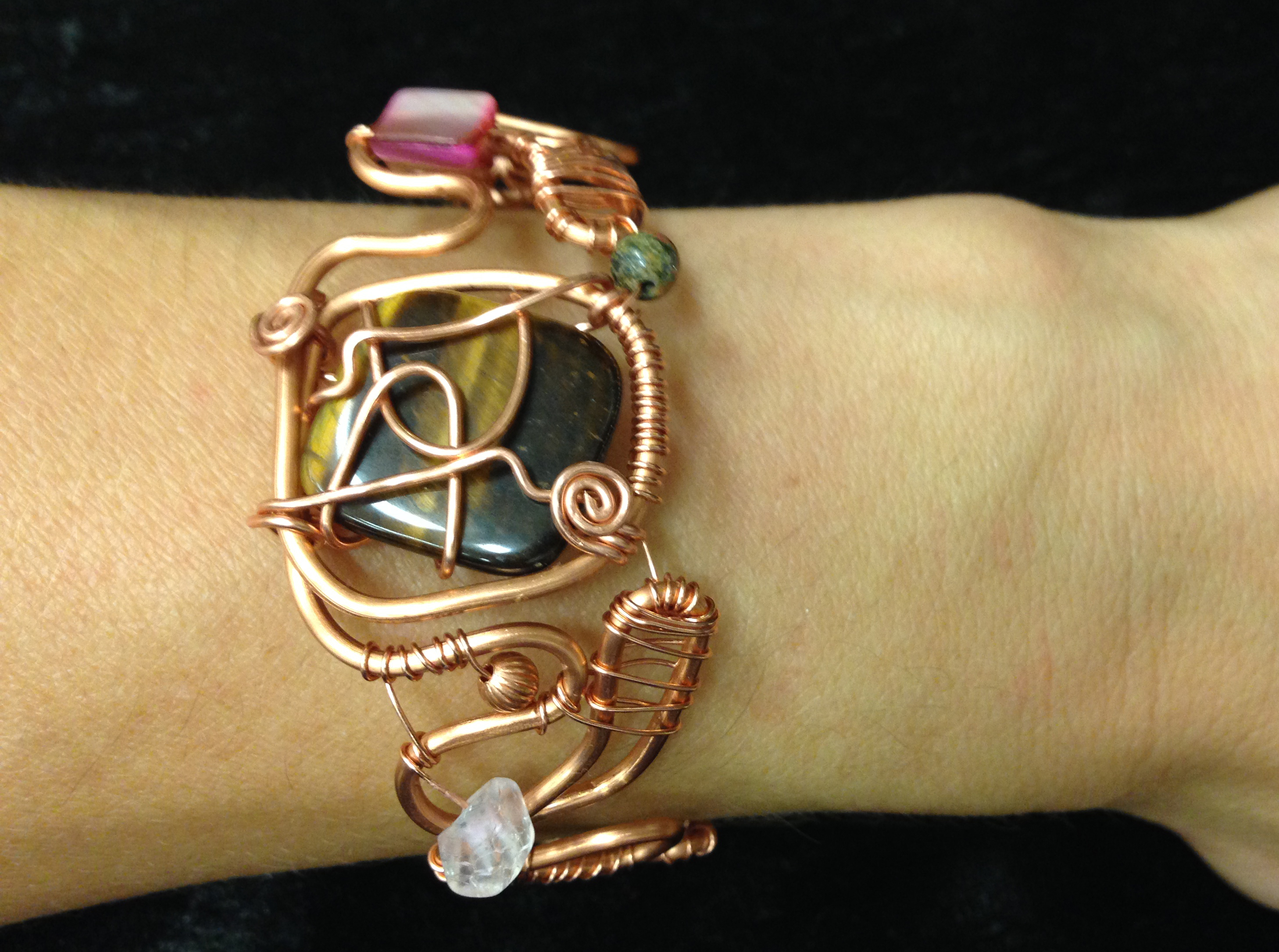 2014 Copper cuff with tiger's eye on hand