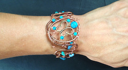 2014 Copper cuff with butterfly and turquoise beads on hand.jpg