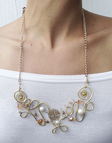 2013-08 LTB Angelic Gold (round necklace on model)