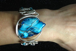 2014 Silver plated copper cuff with blue stone on hand