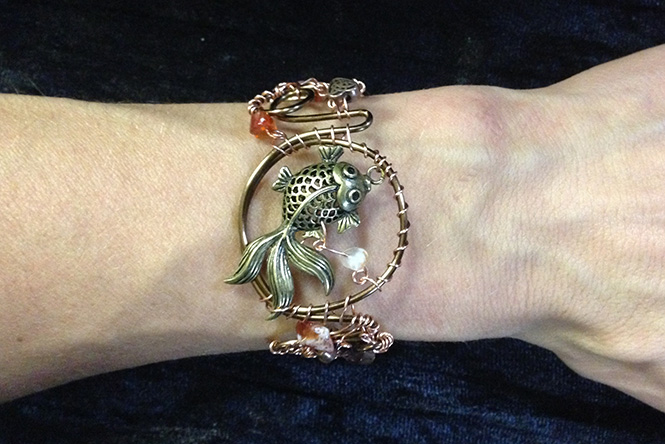 2014 Copper Cuff with Fish on hand