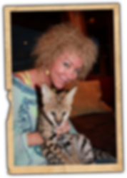 Jennie DeVoe holding a Serval Cat at Tony Stewart's house