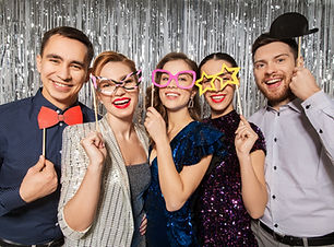 celebration, fun and holiday concept - happy friends posing with party props.jpg