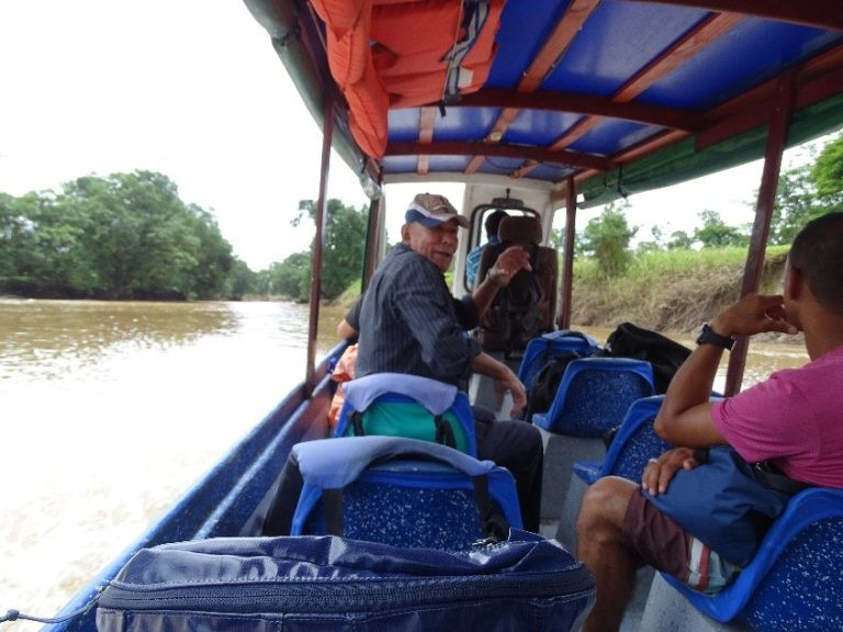 Talking to the locals on the river transport Costa Rica