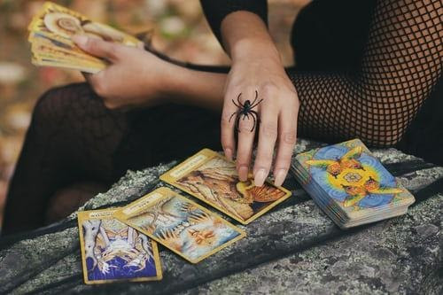 hands tarot cards spider ring