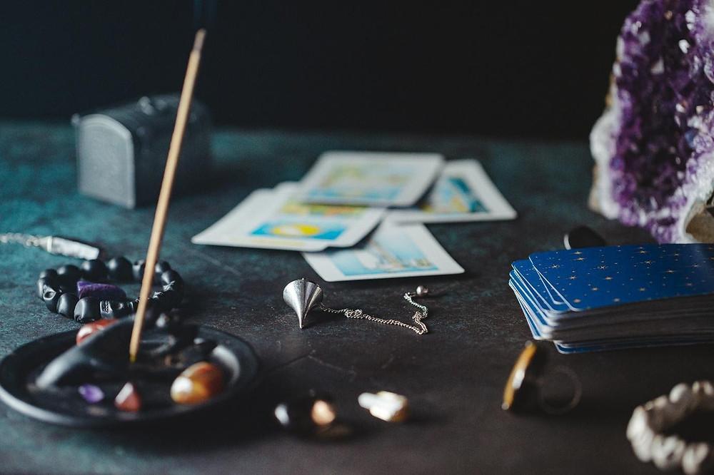 Incense crystals pendulum and tarot cards