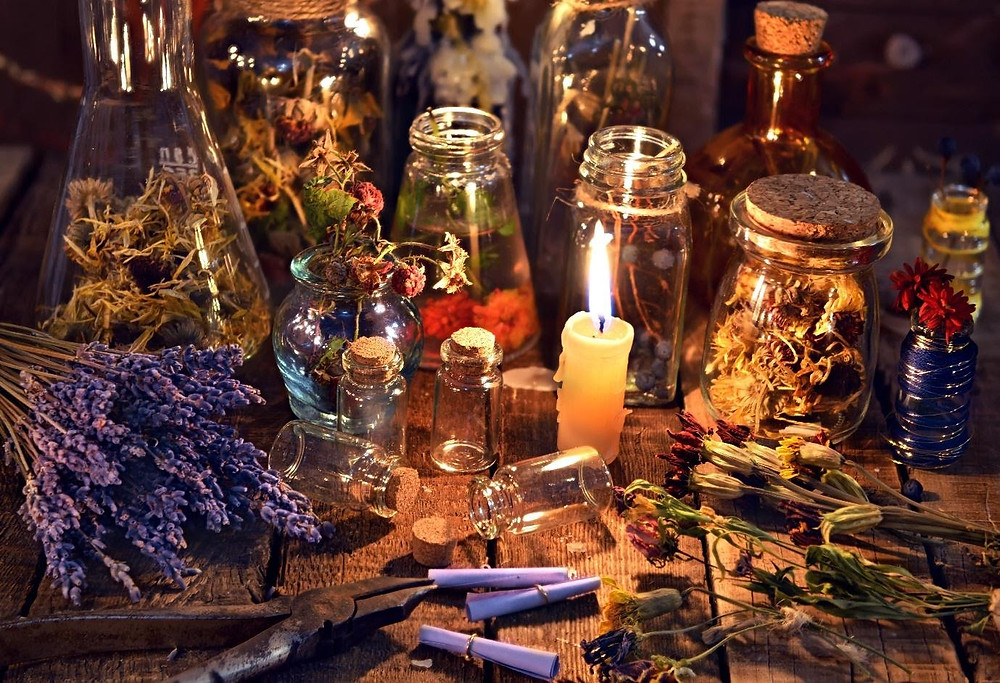 Dried herbs and candles for Witches magic spells, Witchcraft for beginners.