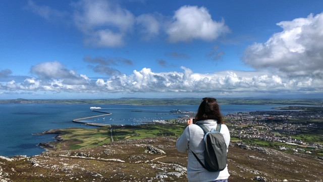 Tony taking a photo of Rosie taking a photo of Holyhead Port and Breakwater