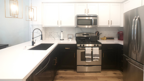 White Kitchen Countertops on White Upper Cabinets with Black Lower Cabinets