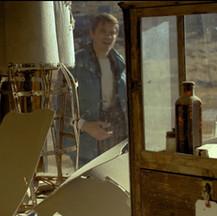 Daniel at abandoned gas station - Film Still