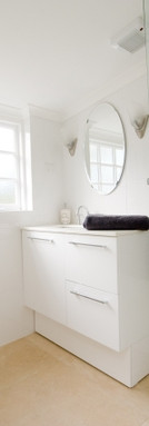 The sparkling modern bathroom is completed with lovely soft towels, bathrobes, hairdryer and other bathroom amenities.