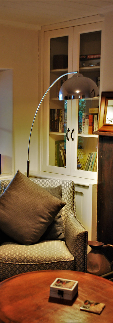 Chair and light are placed for a perfect reading position in the sitting room.