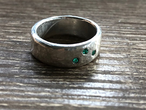 Triple flush set faceted emerald ring