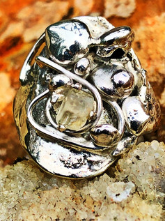 silver and topaz conglomerate ring