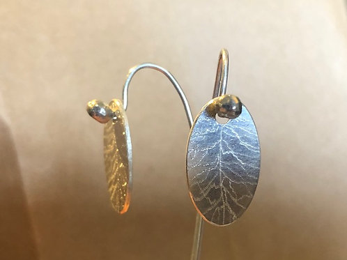 Oval hand-etched long back earrings.