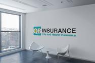 Logo on Wall Mockup - QB Insurance.png