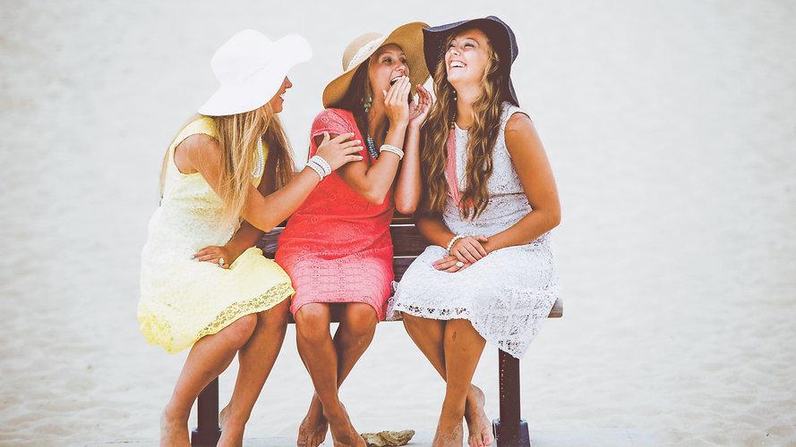 three women sitting on brown wooden bench_edited.jpg