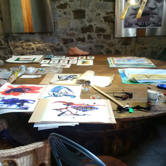 Some of our work laid out on the large table in the studio.