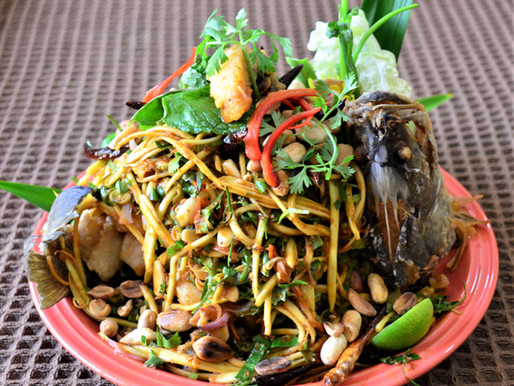 Crunchy green mango and fried fish salad with chilli and strawberry jam sauce