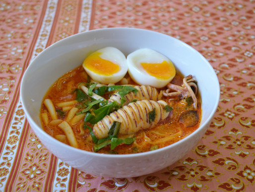 Calamari and egg noodle soup, or tom yam  plameuk