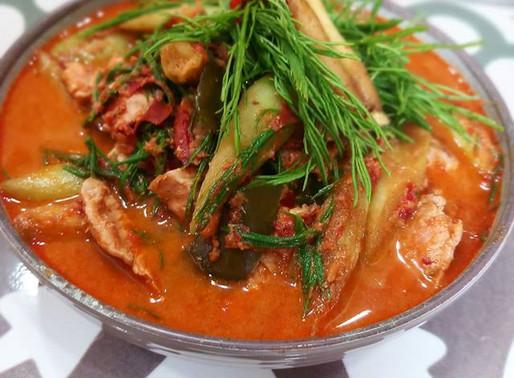 Pork curry, taro stems and acacia leaves