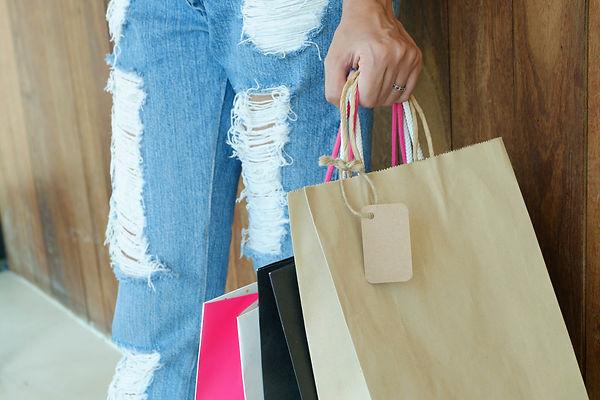 Canva - Closeup of Woman Holding Shoppin