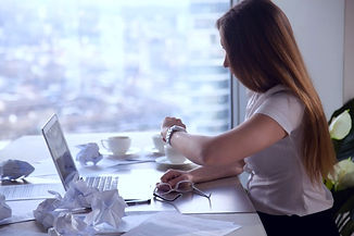 overworked-businesswoman-looking-wristwatch-checking-time-meet-deadline_1163-4309_edited.jpg