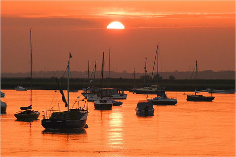 Sunset & boats on river alde in suffolk-