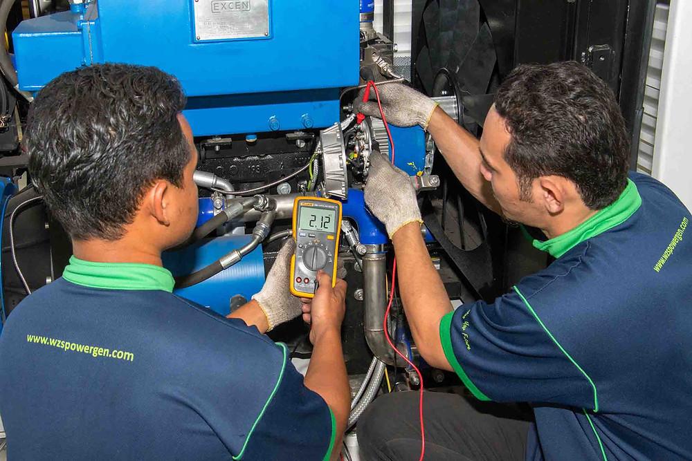 Technicians reading using a meter gauge