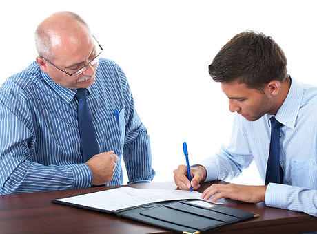 senior and junior businessman discuss an