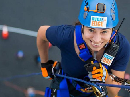 Don't look down: Brave participants rappel 428 feet to raise money for Give Kids the World