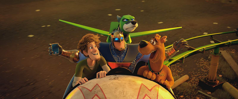 "Shaggy voiced by WILL FORTE, Blue Falcon voiced by MARK WAHLBERG, Dynomutt voiced by KEN JEONG, and Scooby-Doo voiced by FRANK WELKER in the new animated adventure ""SCOOB!"" from Warner Bros. Pictures and Warner Animation Group. (© 2020 Warner Bros. Entertainment Inc. All Rights Reserved.)"