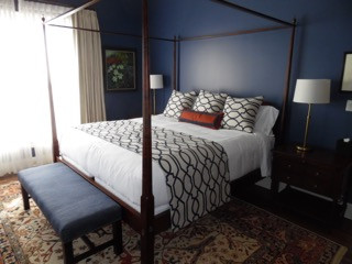 The jewel tones in this pace are complimented by a neutral coverlet.