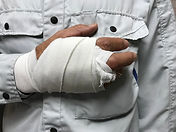 Male worker who injured his hand during