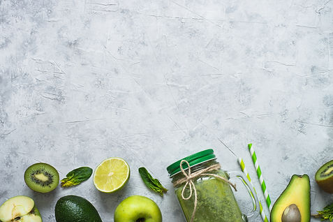 Healthy green smoothie in mason jar and