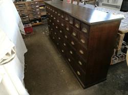 Sensitive repair of large chest of drawers