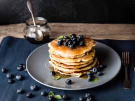 Homemade fluffy pancake with honey