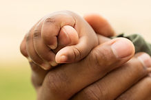 Father holding his daughter's hand..jpg