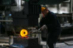 man-lifting-hot-metal-2880872.jpg