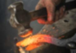 man-forging-metal-3680094_cropped.jpg